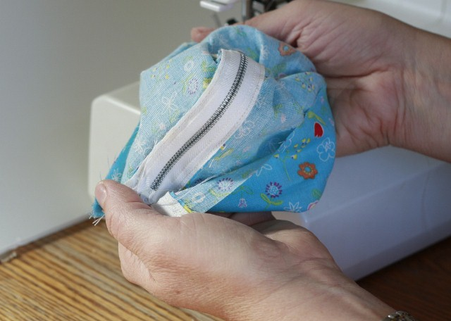 To sew the side seams, begin by turning the tube inside out.